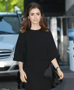 Abbey Sofa Lily Collins Looks Chic In A Loose Fitting Minidress