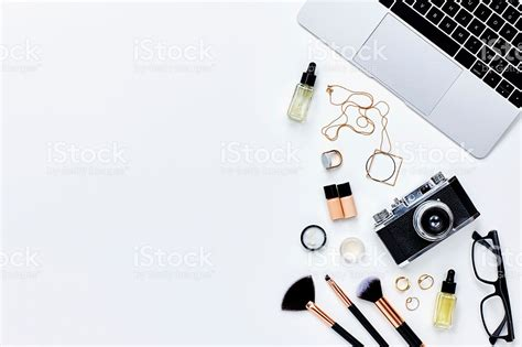 camera wallpaper for tablet various beauty products with camera and laptop on white