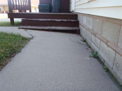 sunken sidewalk house wauwatosa mudtech wisconsin