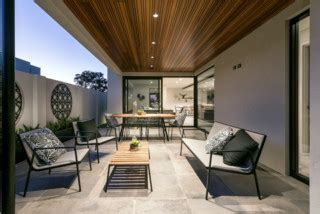 modern alfresco area  feature timber ceiling