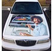 Bob Ross Painting On A Car Hood Of Space
