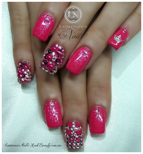 Acrylic Gel pretty pink gel nails with crown bling