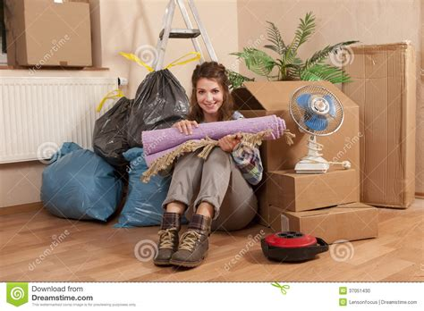 Move Your On The Floor by Sitting On The Floor Between Waste And Moving Boxes