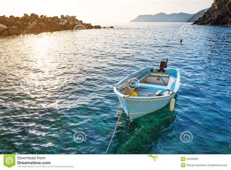 cost of fishing boat fishing boats at the coast of ligurian sea stock photo