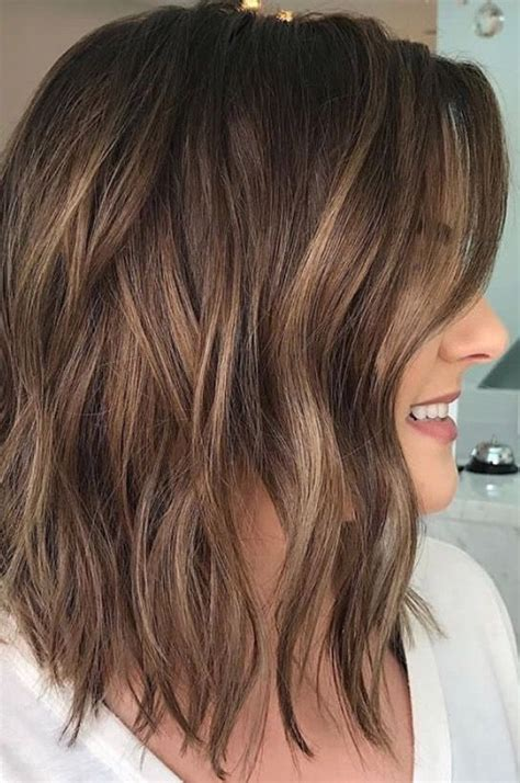 long brown hairstyles with parshall highlight brunette balayage wavy hair brown highlights long