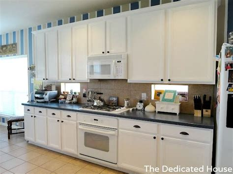 paint grade kitchen cabinets how to paint builder grade oak cabinets white