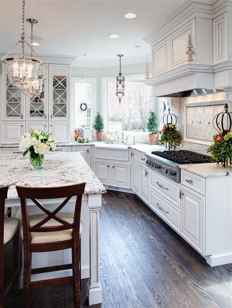 traditional white kitchens traditional white kitchen with eat in island designers