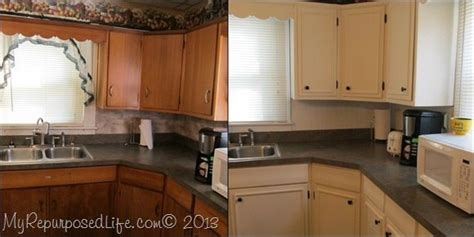 applying wood trim to old kitchen cabinet doors kitchen cabinets updated with paint trim my repurposed