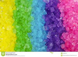Multi colored crystal rock rainbow background stock images image