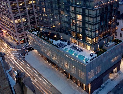 trump soho new york trumps city s real estate with a trump soho suffers trump slump announces layoffs
