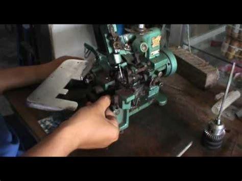 Mesin Obras Kecil memperbaiki mesin obras masalah macet looper bengkok