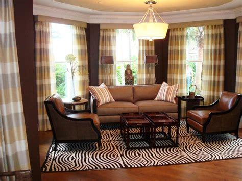 brown living room  zebra rug  plaid window