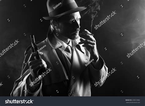 film noir gangster movies film noir attractive gangster trench coat stock photo