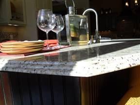 triple waterfall edge on new venetian gold kitchen