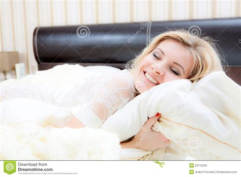 lying or laying in bed beautiful woman lying in bed stock photos image 23712533