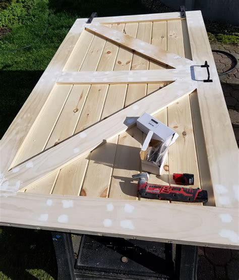 building a sliding barn door how to build a sliding barn door for less the honeycomb home