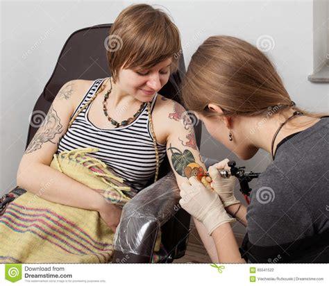 tattoo drawing process tattoo process master drawing flower tattoo stock photo