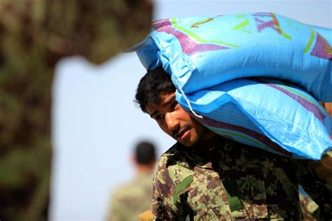 residents help unload humanitarian aid from a black hawk helicopter in dvids news ansf and isaf provide humanitarian aid to