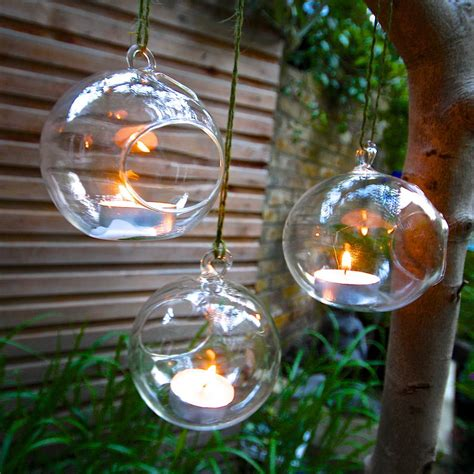set of four hanging tealight bubbles by london garden