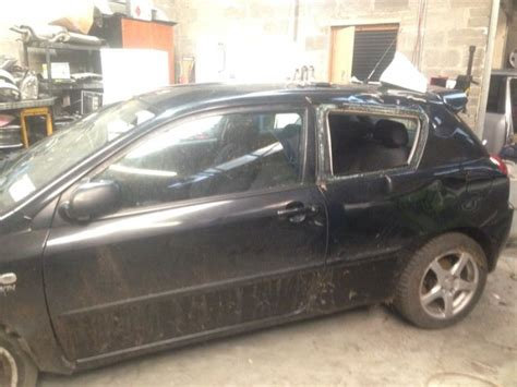 2002 toyota corolla black 2 door for repair or parts for