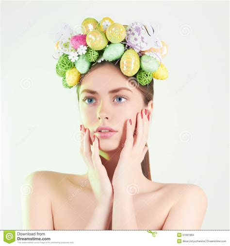 easter time avarde look hairstles spring woman beautiful girl with easter eggs stock photo