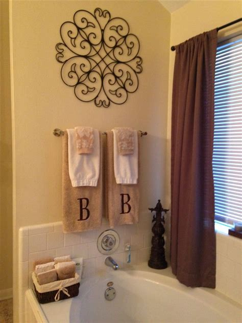 how to decorate a bathroom towel rack