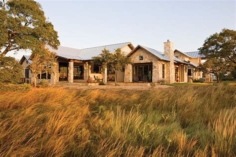 limestone ranch house with recycled barn wood yes