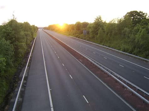 Empty Grid sunset over an empty motorway 169 stephen sweeney cc by sa 2