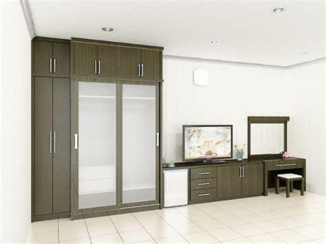 Lemari Pakaian Pintu 3 Sleding Motif Bunga Kayu Jati 10 model lemari pakaian minimalis