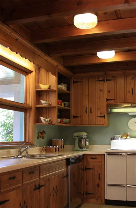 kitchen cabinets on knotty pine walls a knotty pine kitchen respectfully retained and revived