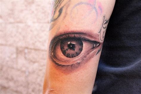 tattoo eye with clock clock eye by jeff norton tattoonow