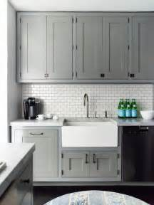 Gray And White Kitchen Cabinets Kitchen Grey Cabinets Apron Sink White Subway Tile Back Splash And Light Countertops