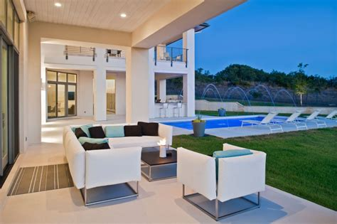 house fountain design architecture relaxing patio with white sofa and beautiful fountain pool design