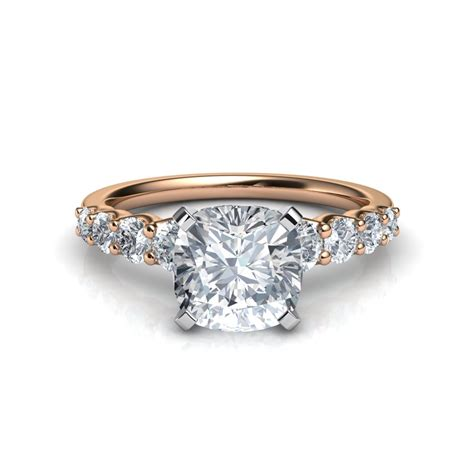graduated side cushion cut engagement ring