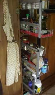 Rv storage food pass thru bins and tots hidden behind