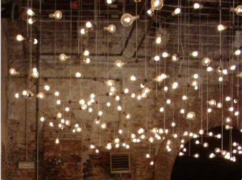 vertically hanging globe string lights the love day