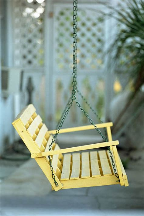Yellow Porch Swing a yellow porch swing photo