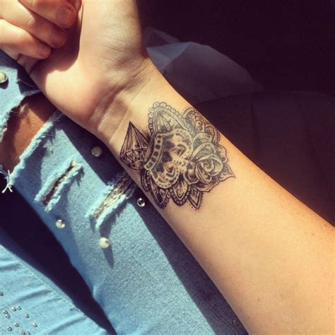 rose on wrist tattoo wrist crown leafs
