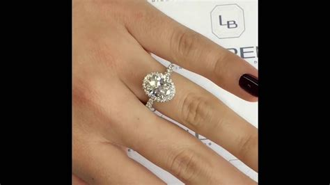 1 ct oval ring on 2 carat oval halo engagement ring