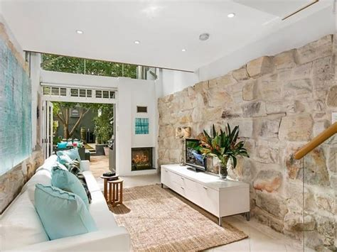 living room modern living room with nice fireplace nice living room with stone feature wall and in built