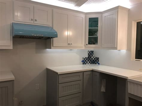 bottom kitchen cabinets white shaker upper cabinets and grey shaker base cabinets with pure white quartz countertops for