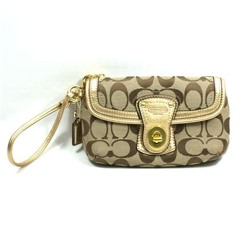 Coach Legacy Gold coach legacy signature capacity flap wristlet gold 41941