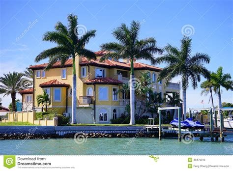 boat house by the bay panorama of luxury beach house with boat dock stock image