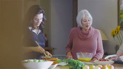 Happy In The Kitchen A Dinner A Signing by Happy Family Preparing A Meal Together In The