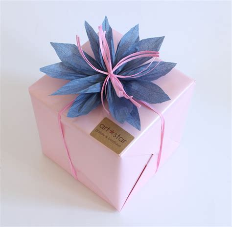 How To Make A Paper Present Bow - make this raffia flower gift bow