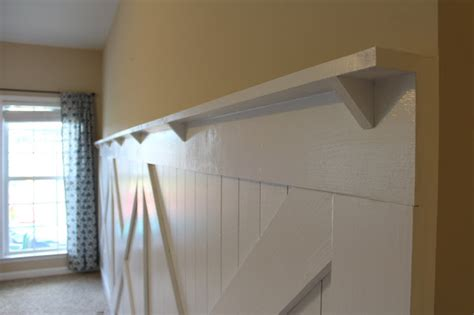 Wainscoting Shelf by Barn Door Wainscoting Tutorial Remodelaholic