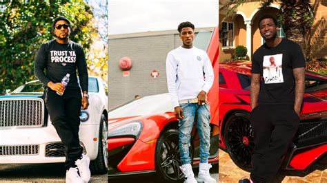 rappers showing   expensive cars jewelry
