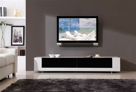 Flat Living Room - ideas brown wood wall mounted tv stand with laminate wood flooring and beige shag rugs
