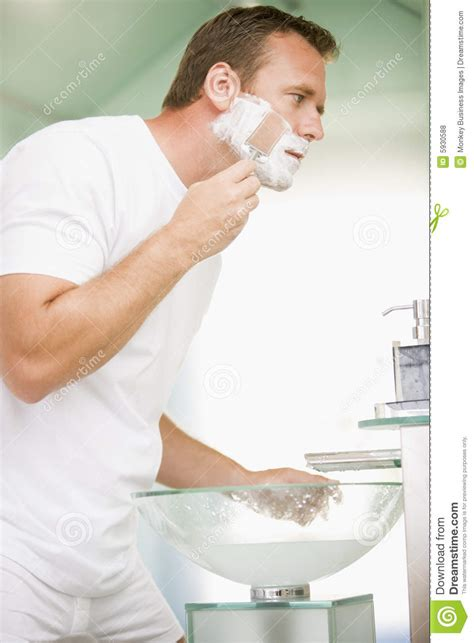 shaving in the bathtub man in bathroom shaving royalty free stock photos image