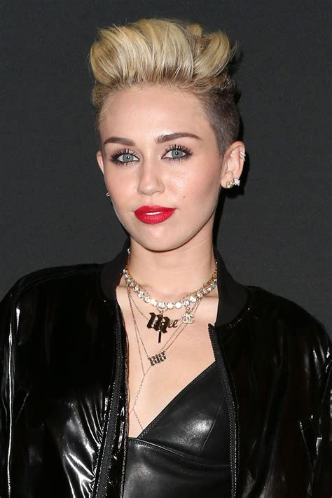 Wajah Rich miley cyrus slaps rear end of person on